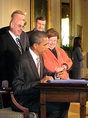 President Obama Signing a bill into law
